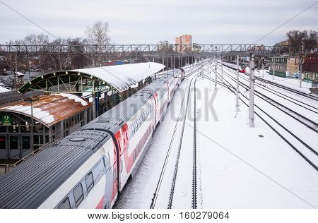 Moscow Russia - February 7 2016: Two storey wagon brand sedentary train rides on Ramenskoye Moscow region in winter
