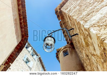 lamp on stone wall in eze village