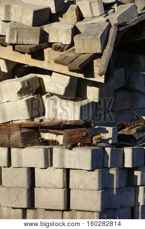Pavement pallet crumbling objects building bad condition.