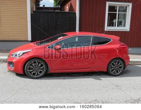 Red Kia Rio Car