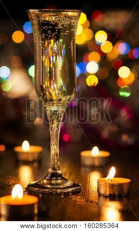 Lovely romantic dinner. Glass of champange with boken background