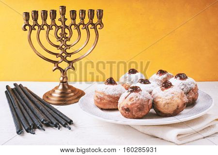 Hanukkah still life with menorah and sufganiot