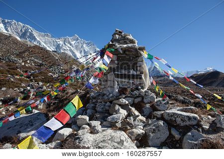 Nepal - October 24, 2015: Buddhist Prayer Flags On A Chorten Memorial To Honor The Great Polish Clim