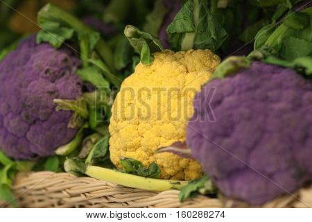 Close up of cauliflower and broccoli on market stand in supermarket