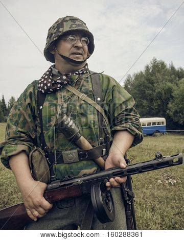PERM RUSSIA - JULY 30 2016: Historical reenactment of World War II summer 1942. German soldier with submachine gun