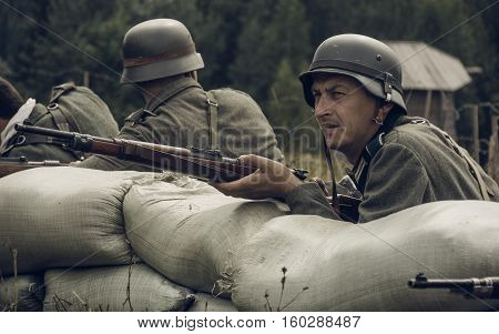 PERM RUSSIA - JULY 30 2016: Historical reenactment of World War II summer 1942. German soldier with rifle