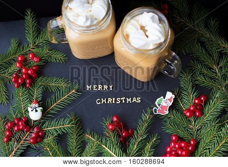marshmellow hot cocoa trees in the background. The inscription Merry Christmas
