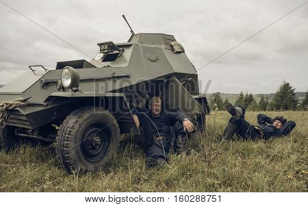 PERM RUSSIA - JULY 30 2016: Historical reenactment of World War II summer 1942. Crew of soviet armored car