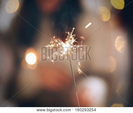 Close up view of sparkler on blurred background