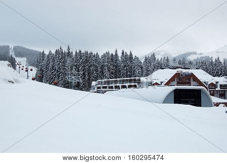 Jasna Slovakia - January 18 2012: View of the cable car and hotel Grand snowy winter in Ski resort Jasna Low Tatras.