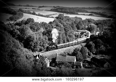 Steam train on the hill in Dorset in England.