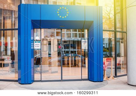 STRASBOURG FRANCE - MARCH 24 2015: Official delegation entrance to Council of Europe European Union with blue gate and European Union Stars logo above and white security code badge on the door.