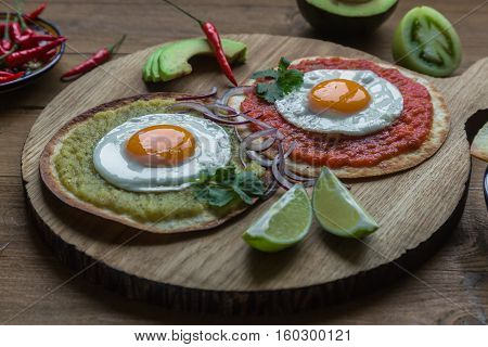 Variety of colorful mexican cuisine breakfast dishes on a table.