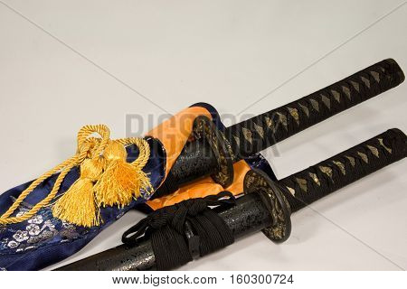 A Japanese sword in a sheath of a black stone pattern
