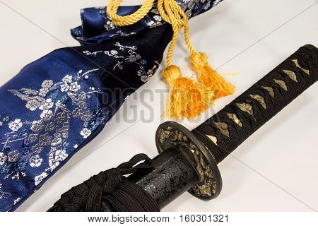 Japanese sword in a sheath of a black stone pattern