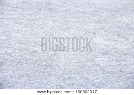 Background texture of ice skating rink with scratches