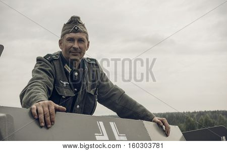 PERM RUSSIA - JULY 30 2016: Historical reenactment of World War II summer 1942. German soldier in armored car
