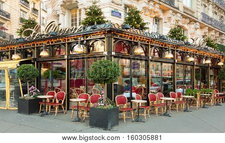 Paris France-December 05 2016: The famous restaurant Le Dome decorated for Christmas located on Montparnasse boulevard in Paris.It was once home for to intellectual stars from Hemingway to Picasso.