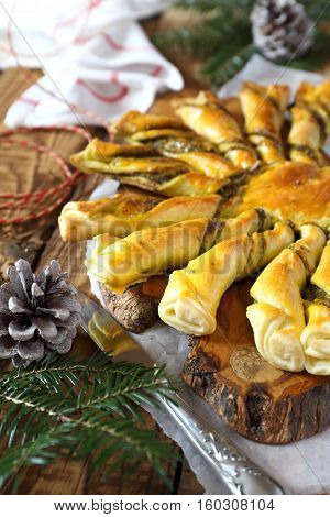 French tarte soleil. New Year pastry: pesto sun pie and fir branch