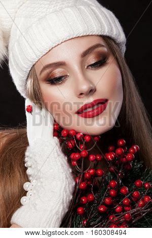 Beautiful Girl In A White Cap And Gauntlets, Holding A Christmas Tree Balls Red