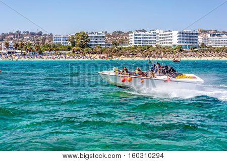 PROTARAS CYPRUS - JULY 16 2016: Tourists riding a jetski at Fig Tree Bay