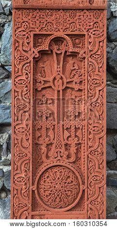 Khachkar the sacred cross-stone on red volcanic tuff in Armenia