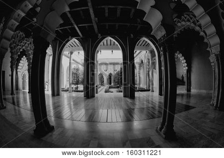 Zaragoza Spain - September 14 2015: Aljaferia Palace hall with arches. Black and white color. Touristic landmark in Zaragoza Spain.
