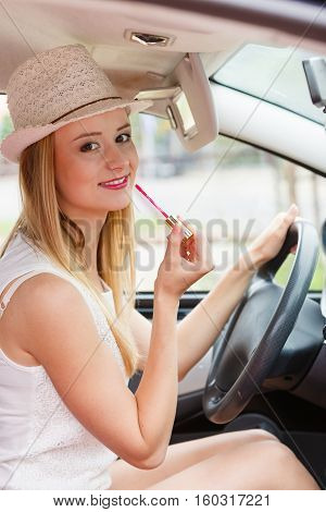 Woman Applying Makeup While Driving Her Car