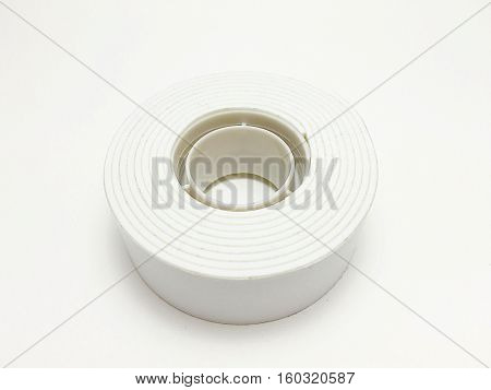 Double-sided adhesive tape on a white background.