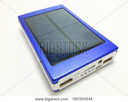 blue Power Bank recharge their batteries with solar power and on a white background.