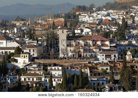 People at the Church of San Nicolas in Granada, Spain