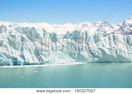 Frontal detailed view of Perito Moreno glaciar in argentinian Patagonia - World famous nature wonder of south american country of Argentina - Natural azure turquoise light blue color tones