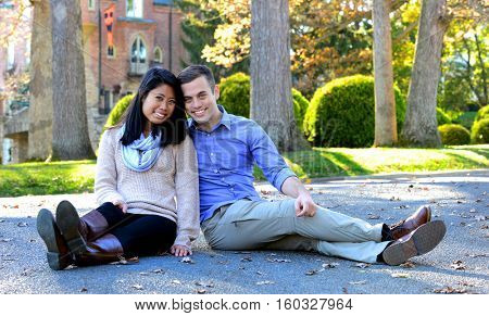 Young attractive couple in love in an autumn setting following their engagement