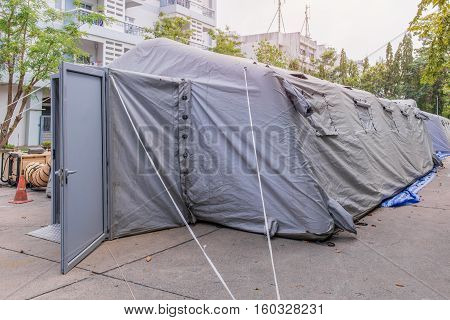 Military tent shelter on the street in town.