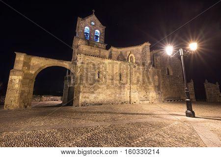 night scene of Church San Vicente Martir and San Sebastian in Frias Burgos province Spain.