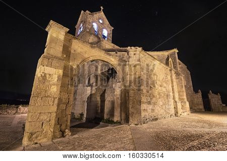 Starry night and Church of San Vicente Martir and San Sebastian in Frias Burgos province Spain.