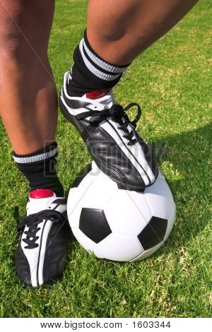 Football Player With A Soccer Ball On Soccer Pitch