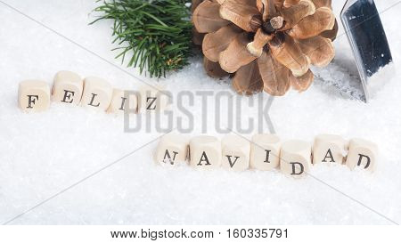 Christmas background with the Spanish words Feliz Navidad of Merry Christmas