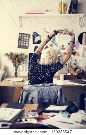 Tattooed Girl Stretching Working Concept