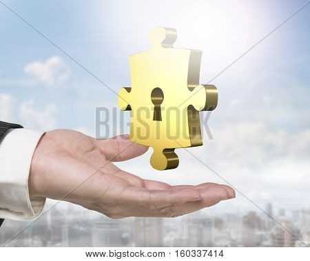 Man Hand Holding Golden Puzzle Piece With Keyhole