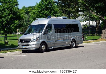 HARBOR SPRINGS, MICHIGAN / UNITED STATES - AUGUST 3, 2016: A Mercedes-Benz Airstream van is parked on West Main Street near downtown Harbor Springs.