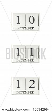 Closeup group of white wooden calendar with black 10 11 12 december word three date calendar isolated on white background