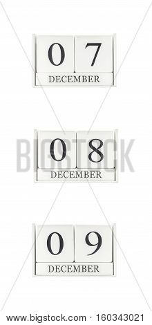 Closeup group of white wooden calendar with black 7 8 9 december word three date calendar isolated on white background