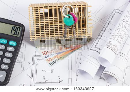 House Under Construction, Keys, Calculator, Currencies Euro And Electrical Drawings, Concept Of Buil