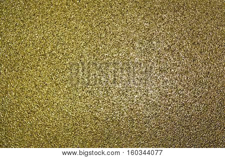 Abstract golden texture, grunge background, grainy abstraction, gold texture