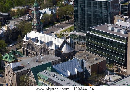 historic buildings contrasted with modern high rise buildings in this high level view of Quebec City Canada