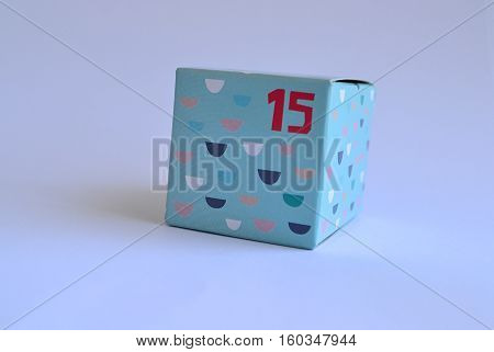 pattern cardboard box with fifteen 15 printed on it in red