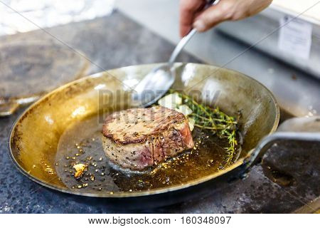 Chateaubriand Of Beef With Rosemary And Garlic Fried In A Skillet.
