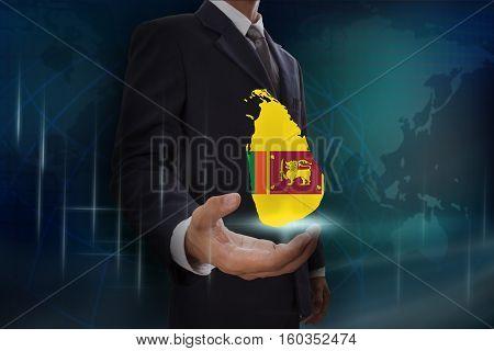 Businessman showing map of Srilanka on globe background