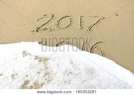 Good Bye 2016 Hello 2017. Inscription Written In The Beach Sand. New Year 2017 Is Coming Concept On
